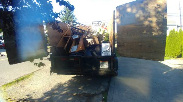 Picked up a pile of junk with dump trailer from a landlord in Tacoma.